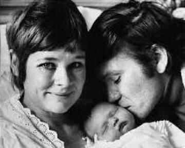 Judi Dench, husband Michael Williams with new baby, Finty. What a sweet picture.