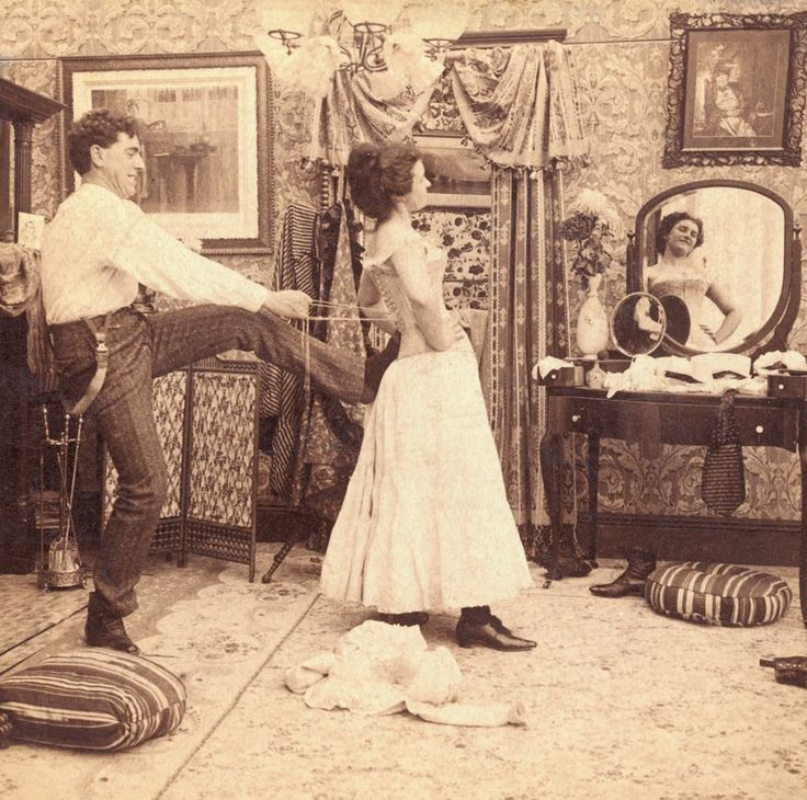 There's a lot of commitment to wearing a corset. A man helping a woman put it on, XIX century.