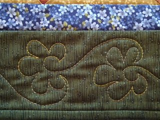 Thread Head: Stylized flower in a border and other great tips