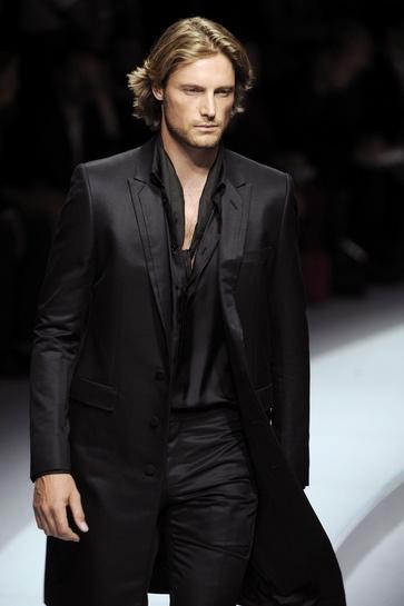 Model Gabriel Aubry walks the runway wearing the Versace Menswear...