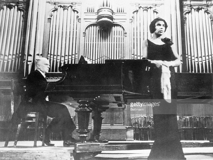 The first concert by Marian Anderson, Negro concert singer, took place on January 15, 1935, in the Grand Hall of the Moscow Conservatory of Music. Photo shows Marian Anderson on the platform of the Moscow Conservatory. At the piano is Kosti Wichanen, her Finnish accompanist.