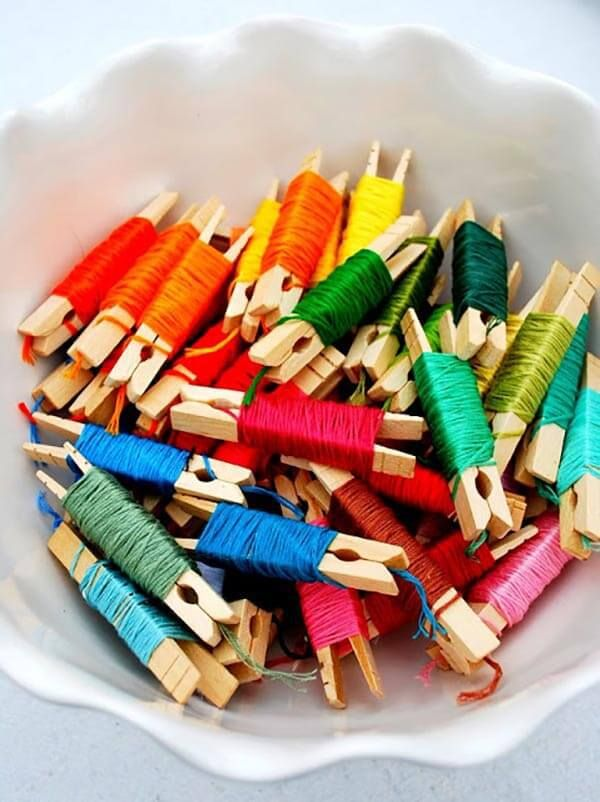 How to organise your embroidery floss with style! How fabulous are these pegs wrapped up in all the colours of the rainbow - A fabulous craft storage hack from Heather J's Life - 15 Stunning Craft Storage Ideas You Will Want To Steal