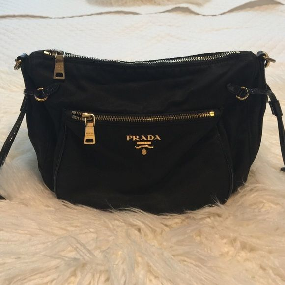 Prada purse Black Prada purse canvas material with patent leather accents. VERY good condition. Prada Bags Shoulder Bags