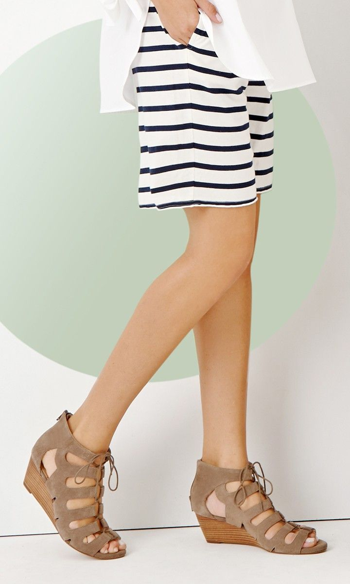 Neutral suede wedges with a gladiator lace-up silhouette and stacked mid heel