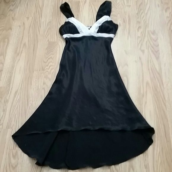 Stunning Satiny Cocktail Dress Beautiful satiny black and white cocktail dress. High to low skirt, cups are slightly padded so you don't have to wear a bra. Just a gorgeous little dress, reminds me of a tuxedo. The dress is very flattering on! Worn once for a Xmas party. Dresses