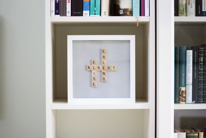 "If you pick up an Ikea Ribba frame or something similar, you can make a charming Scrabble tile NAME FRAME. Simply arrange the letters of your child's name or children's names, or their names mixed with the word ""love"" or other word of your choice. Glue the letters together and adhere them to a white …"