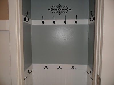 Coat closet....more likely to hang coats in here than on a hanger. Also for bags and purses. Brilliant!!!!