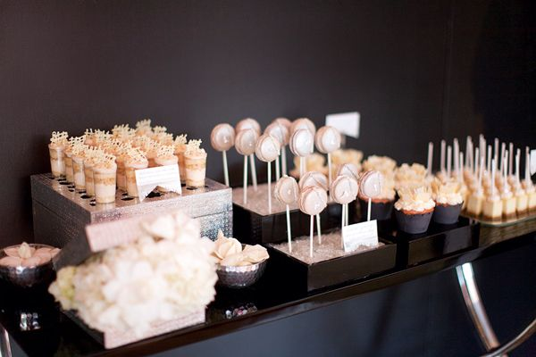 Have a dessert buffet. Mini pastries and other tiny sweets are crowd-pleasers. Save money by having only a small cake for your cake cutting.Photo Credit: Jessica Claire Photography