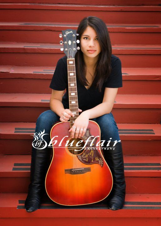 I like the idea of using personal props in senior photography. I think I would like to see a version of this where she was actually playing the guitar and her body was creating some angles in contrast with the horizontal lines created by the stairs.