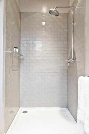 Bathroom with pale grey brick tiles. Thinking this could be in master shower too and buy in bulk.