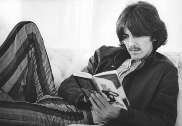 George Harrison also reading about Bob Dylan.