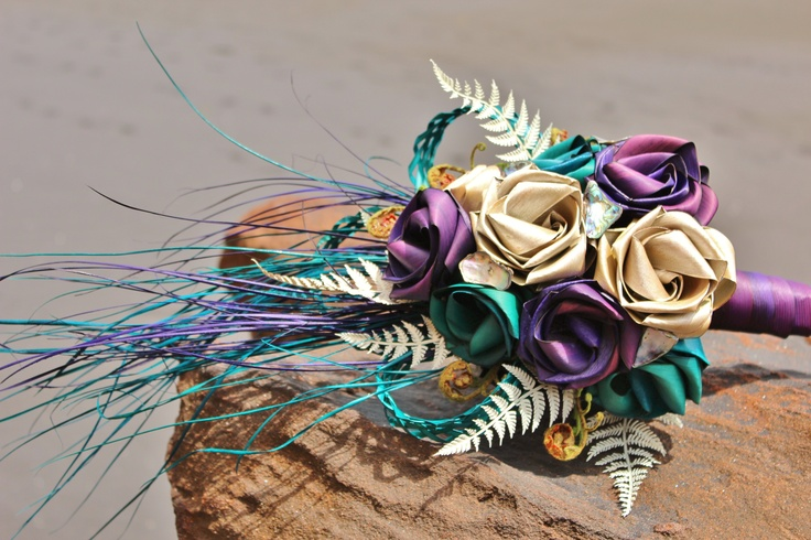 Cascading flax bouquet in purple, pearl white and turquoise with white fern, koru & paua shell. www.flaxation.co.nz