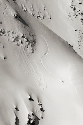 Black and white photograph of skier going down the slopes of Andermatt, Switzerland. Available as poster at printler.com, the marketplace for photo art. Photographer Martin Pålsson