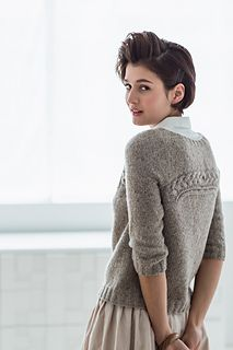 This delicate, feminine pullover bares your arms to the spring sunshine and makes an impact with a pair of bold cables with delicate eyelets along the raglan lines. But the real surprise is on the back, where an innovative arch shape turns the same cable and lace sideways and creates a reversible garment. The body is worked in the round from the hem up, then divided to work the raglan yoke on one side and shaped with short rows to form the arch yoke on the other. The upper yoke and sleeves…