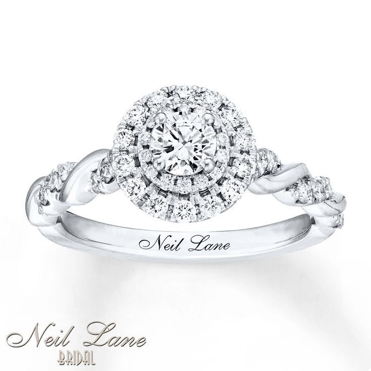 A remarkable 1/3 carat diamond haloed by dazzling round diamonds is the star of this incredible engagement ring from Neil Lane Bridal®. Ribbons of 14K white gold intertwine with lines of glittering diamonds along the band for a total diamond weight of 3/4 carat. Neil Lane's signature appears inside the band. Diamond Total Carat Weight may range from .69 - .82 carats.
