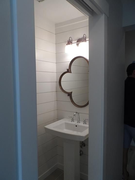Small Powder Room Features Walls Clad In Shiplap Lined