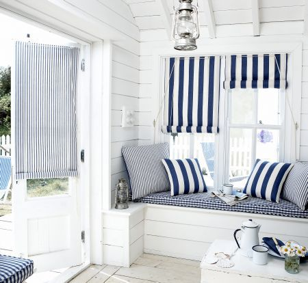 Prestigious Textiles - Maritime Fabric Collection - Maritime blue and white striped roman blinds, striped cushions and blue and white tartan seating pads:
