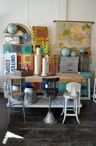 Rescued vintage school furnishings, maps, globes and textbooks lend a learned and nerdy air to home decor