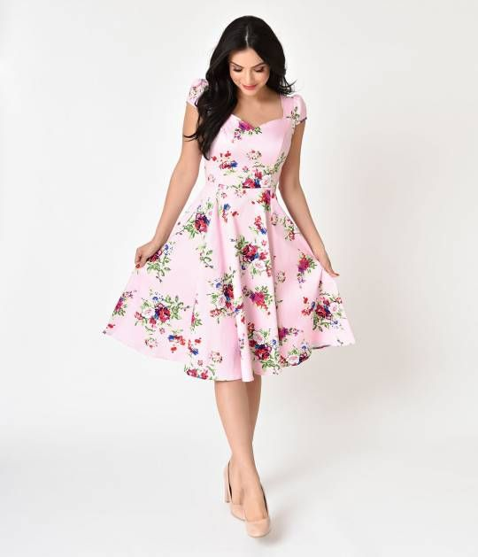 Pin-up perfection on pointe! A sumptuous circle printed stunner in soft pink and a rich florals, the Royal Ballet dress is a perfectly patterned frock in a marvelous midcentury cut. With a fairytale-like sweetheart and cap sleeved bodice that's formed to