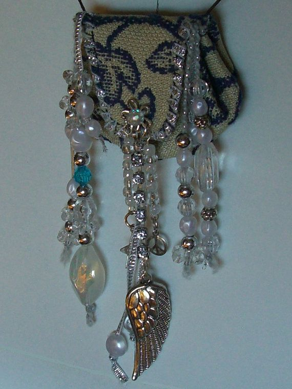 ON ANGEL WING  necklace diffuser designed by nayhotzeoriginals