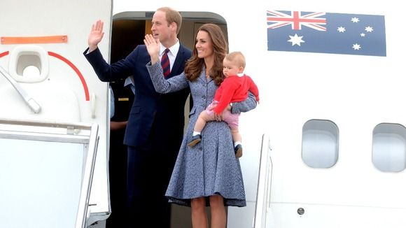 The family wave farewell to Australia as they board a plane in Canberra. Credit: Alan Porritt/AAP/Press Association images