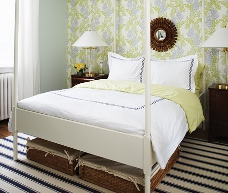 Add painted metal pipe to bed feet to raise bed, then use baskets for storage?- how awesome is THIS?!!