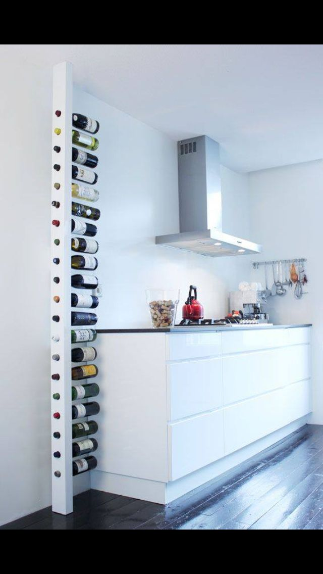 Simple sleek way to story your wine in a modern kitchen white wine rack