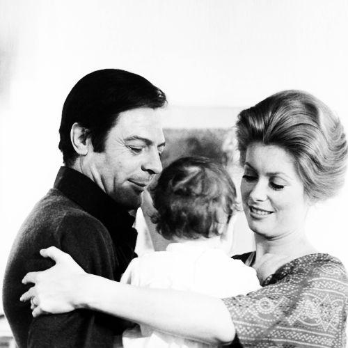 Marcello Mastroianni and Catherine Deneuve hold their daughter Chiara.