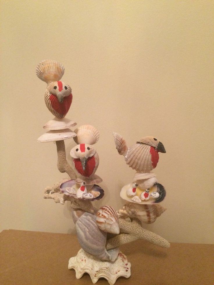 Sea shells birds and nest art sculpture