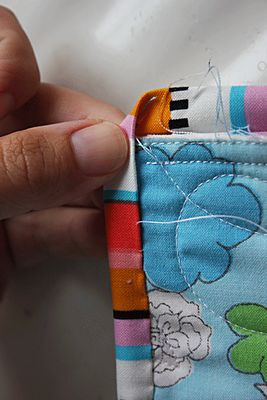 Great quilt binding technique here. Lots of photos and easy instruction on corners!