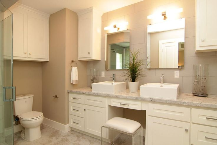 ensuite master bath features large vanity with dual vessel