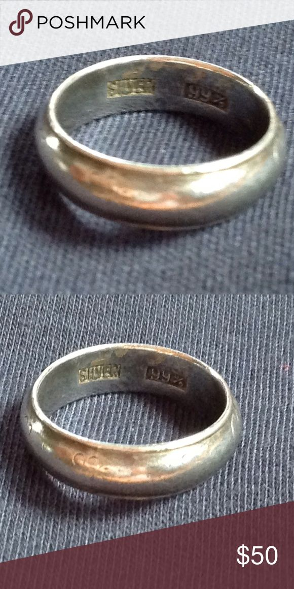 Antique Silver Band 999 Antique Fine Silver 999 Band with a very faint design on the ring, barely visible to the eye but the camera is picking it up. Jewelry Rings