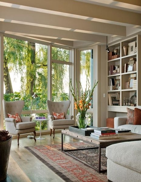 love the open windows combined with the floor to ceiling book shelves