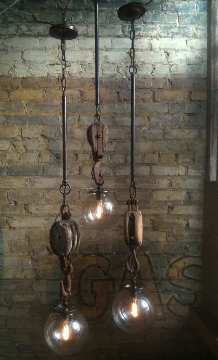 Vintage Industrial Inspired Lighting. Aaron can use that wooden pulley for something :)