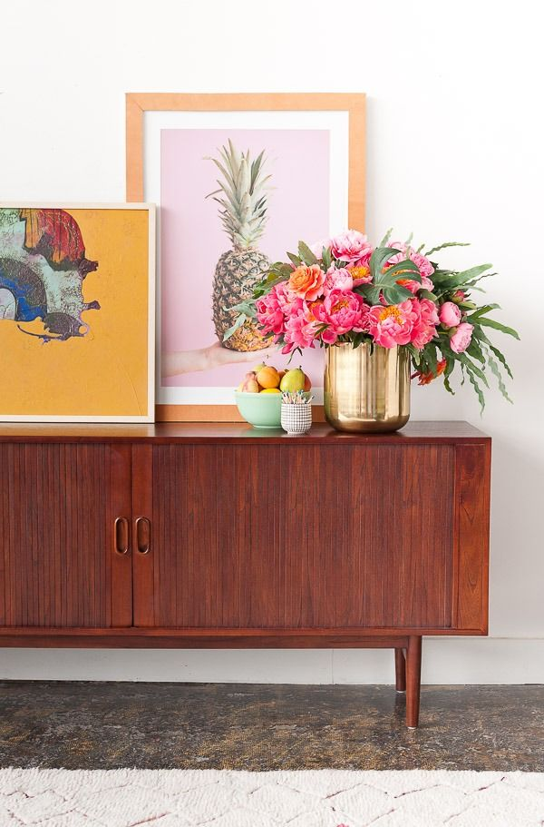 Loving the way our standing gold planter was creatively used to style this Mid-Century sideboard! Seen on Paper & Stitch