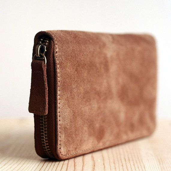 A beautiful hand made designer high quality yak wool phone wallet.It is made with custom design, and solid crafting. All's that makes the purchase worth it.【$69】