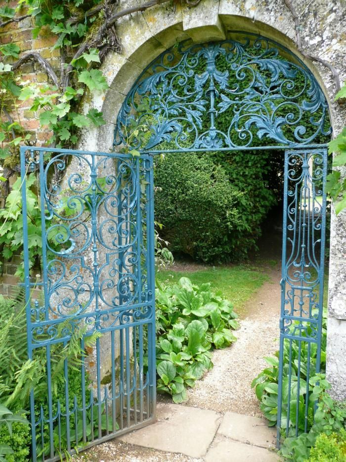 "Paint Colors for Iron Gates and Fences by Kendra Wilson - - - A glorious gate in the garden at Rousham, near Oxford. ""The color used here is Prussian blue. Such a color is found occasionally on 18th century ironwork."" More of this, please."