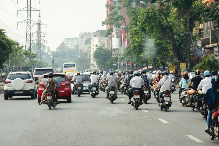 Hanoi Traffic - Taken on a car in Hanoi, leaving for Halong Bay. It is crazy how many motorbikes are on the roads.