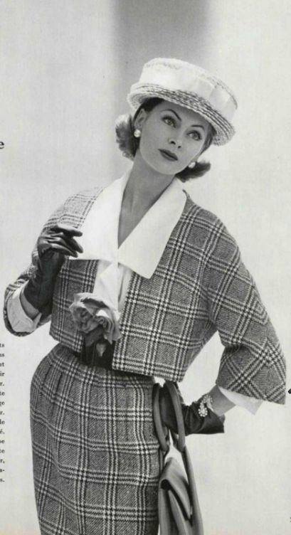 1959   Model in black and white Prince of Wales check suit worn over white crêpe de chine blouse by Maggy Rouff