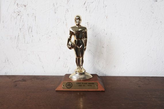 Check out this item in my Etsy shop https://www.etsy.com/listing/494499110/awesome-vintage-football-trophy-70s