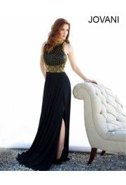 Posh and panache are the surely the synonyms for this Jovani (92827) gown. The golden stud work on the leather appearing bodice makes is classic and chic. The small side-slit is in line with in-vogue fashion tenet where little skin show is truly sensuous. Cut a fine figure with this   posh and foxy gown.