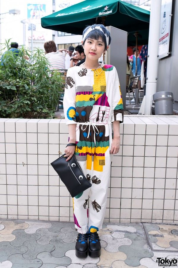 Natsuki is a Bunka Fashion College student with blue-silver hair who we snapped in Harajuku. Her look features a graphic jumpsuit with Tokyo Bopper platforms & a googly eyes clutch. Tokyo fashion