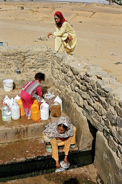 Collecting water from the local well close to the Sahara desert, Morocco by iancowe, via Flickr