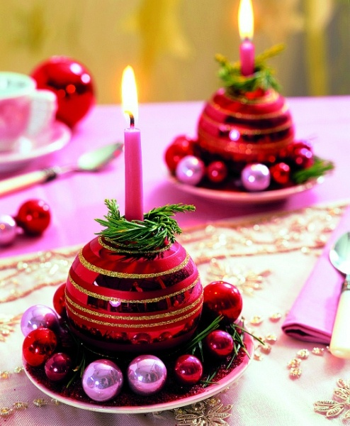 Christmas ornaments can be used to hold candles to create miniature table decorations. Just remove the hook insert from the top of the ornament, place on a curved saucer. The ornament can actually be filled with water to act as a tiny vase for greenery too! / moteris.lt