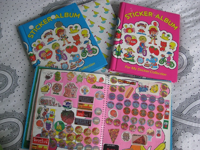 I had this pink sticker album...and it was PACKED full of all kinds of stickers...google eyes, scratch  sniff, glow in the dark, puffy...you name it, I probably had it!