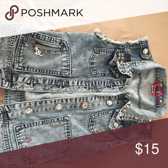 Sleeveless denim jacket This sleeveless denim jacket is studded all in the front and on the collar. It has some pink stars on the left bottom side of it. AKDMKS Jackets & Coats Jean Jackets