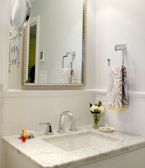 "Master Bath redo: Delta ""Dryden"" faucet and fixtures,  Floor, vanity & shower area- all Carrara marble  Paint- SW 7661 Reflection"