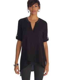 Long sleeve tunic top with lightweight feel gets a modern update with asymmetrical high-low hem and side slit. Satin finish lines the henley style neckline along with silvertone hardware.