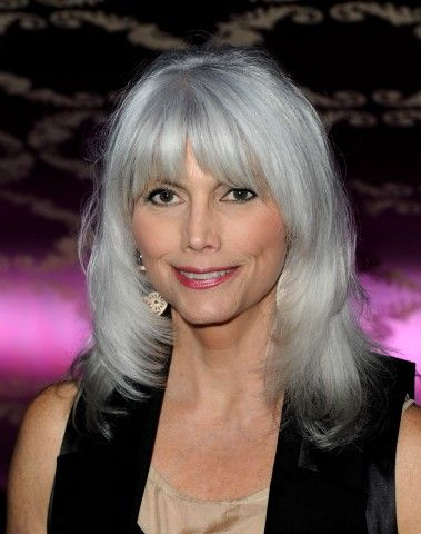 Emmylou Harris' trademark gray hair is a flashy shade of bright silver, which she keeps youthful with an up-to-date 'do that frames her pretty face with bangs and layers.More Hairstyles for Older Women:Short Haircuts Over 50Bob Hairstyles Over 4010 Perfect PonytailsShort Hair Over 40Red ...