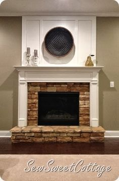 DIY board and batten fireplace remodel--under $65 dollars for an easy transformation. This is what I'd like to do to my fireplace.